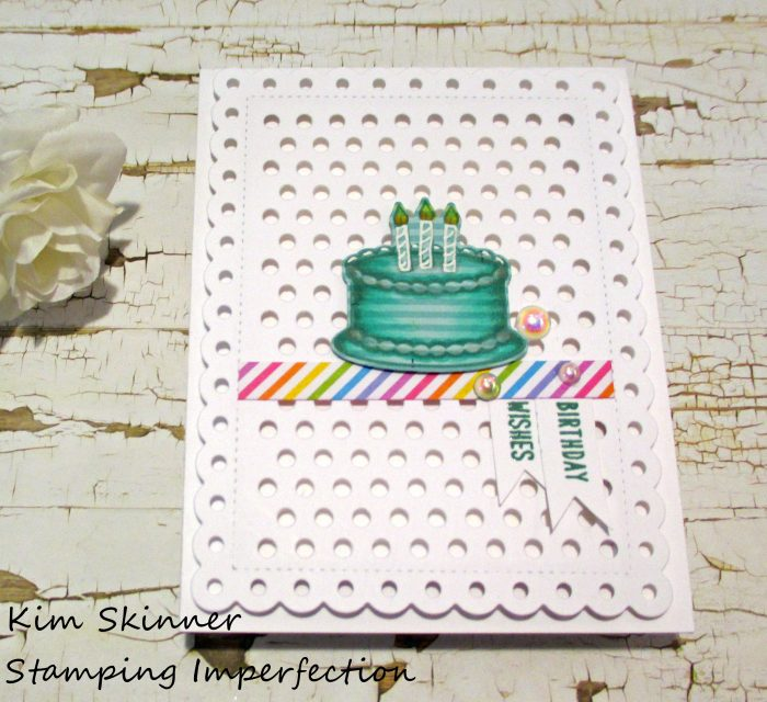 Stamping on patterned paper and adding marker details