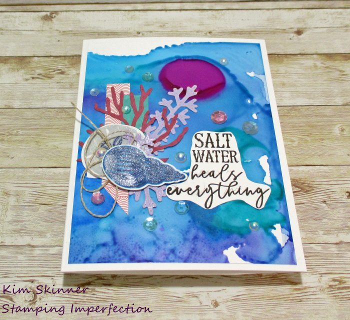 catherine pooler's unsinkable collection with alcohol ink background